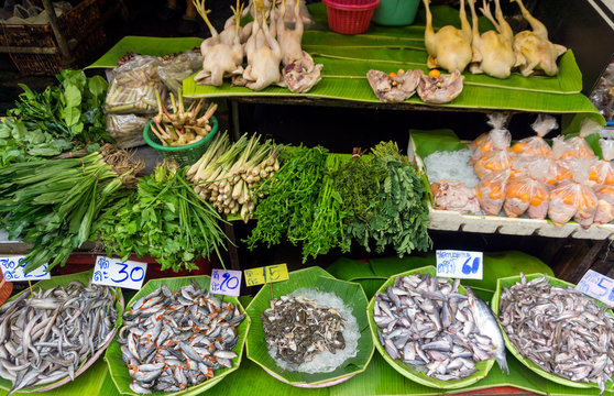 Fish, chicken and herbs on local market