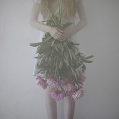 Caucasian teenage girl holding flowers upside-down