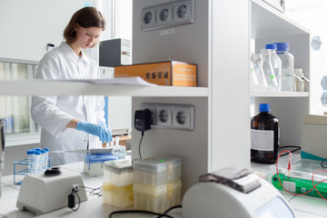 Woman in whites working in lab