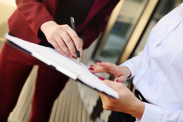 business women sign a contract or documents