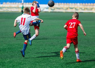 kids play football tournament and enjoy their game on the stadium