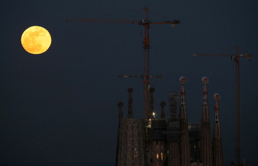 "A full moon ""Super Blue Blood Moon"" rises behind Sagrada Familia Basilica in Barcelona"