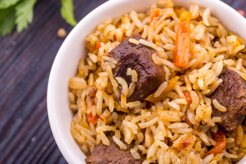 Meat pieces in pilaf with rice and carrot