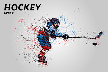Hockey player hits a hockey stick. Hockey from the particles.