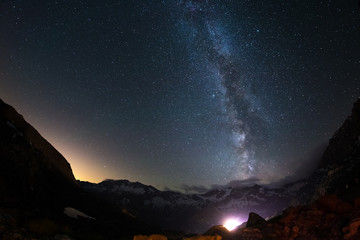 Milky Way arch and the starry sky on the Alps. Fisheye scenic distortion and 180 degree view.