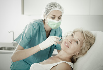 Mature female receiving cosmetic injection