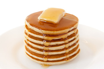 Pancakes Stack with Butter and Maple Syrup isolated on a white background. Shrove Tuesday. Mardi Gras. Pancakes Day. Food. Family Breakfast. Brunch. Dessert. Snacks. Sweets.