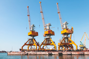 Port cranes stand on the pier in Burgas