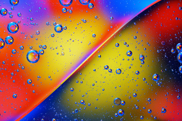 Abstract background of colorful bubbles on the surface of water and oil for your design.