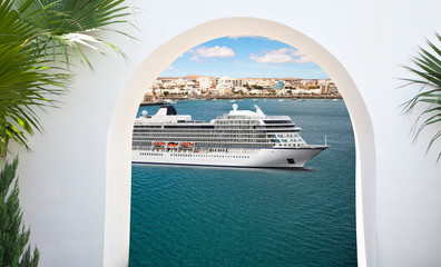 View from under the white stone arch of luxury cruise ship sailing from port