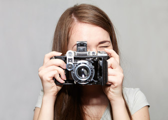 Young girl and retro camera