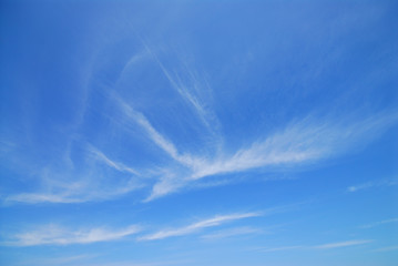 White fluffy clouds in blue sky.
