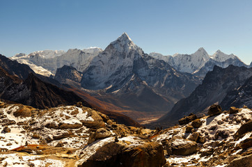 Ama Dablam mountain. Sun illuminates slopes. Himalayan mountains, Nepal.