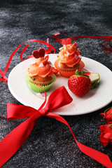 Delicious cupcake for Valentine Day. cake for Valentines day with chocolate and strawberries. Traditional homemade with red roses