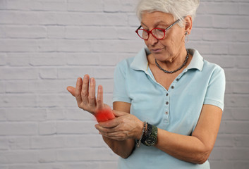 Senior Woman suffering from Wrist Pain , arthritis