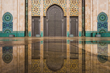 Fotorolgordijn Marokko view of Hassan II mosque's big gate reflected on rain water - Casablanca - Morocco