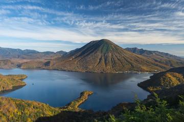 Lake Chuzenji by Mount Nantai against sky