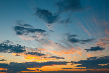 Beautiful colorful clouds with evening sunset in the background