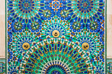 full frame shot of moroccan traditional water tap decorated with colorful shapes of mosaic in Hassan II mosque - Casablanca - Morocco