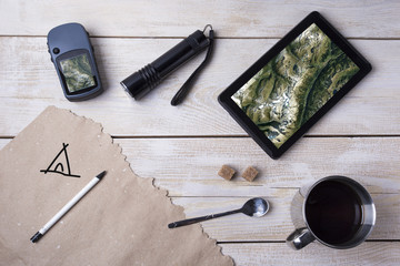 Top view travel concept with outfit of traveler on wooden background, Tourist essentials.