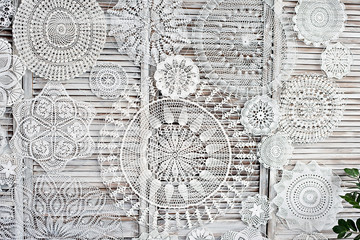 Macrame made by hands. Panel with needlework. Beautiful white patterns with your own hands.