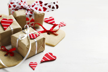 Gift boxes with decorative red hearts and heart shaped cookies. Festive background.
