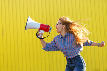 Girl activist shouts in loudspeaker