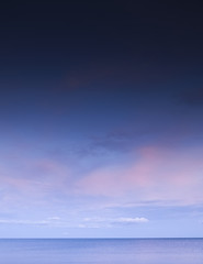 Beautiful morning sky with blue and pink tone, scattered clouds, Seascape