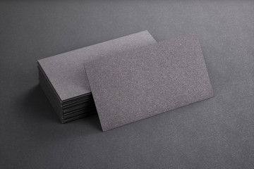 3D rendering of business card. Blank template black Business Cards on black background.