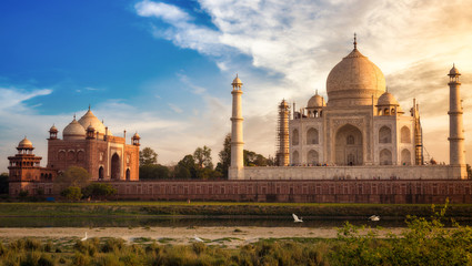 Wall Mural - Taj Mahal Agra with view of the east gate at sunset with moody sky