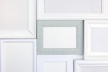 set of various empty white wooden frames on white background