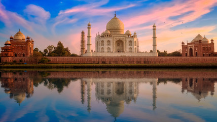 Wall Mural - Taj Mahal Agra India at sunset with moody sky and mirror reflections.
