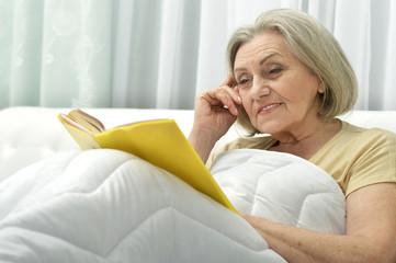 beautiful senior woman with book