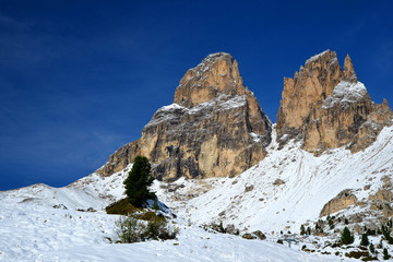 Mountain group Sassolungo (Langkofel). Beautiful snowy winter landscape in Dolomites. Province of Trento, South Tyrol, Italy.