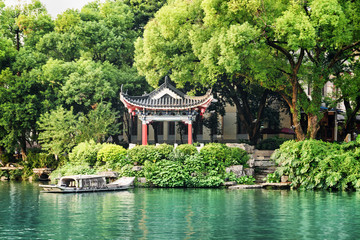 Traditional Chinese pavilion by lake among trees, Guilin