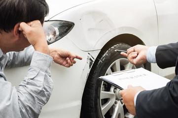senior man and insurance agent claim process after car crash