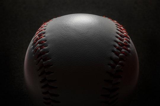 Baseball on black background.