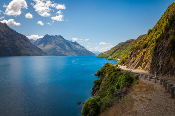 Scenic winding road along the shore at Lake Wakatipu, New Zealand, South Island