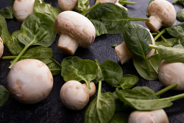 Close up image of fresh mushrooms and baby spinach