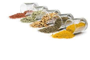 In de dag Kruiden glass jars with various spices on white background with copy space
