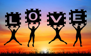 silhouette girl jump hold jigsaw  for valentine day on blurry  sunrise