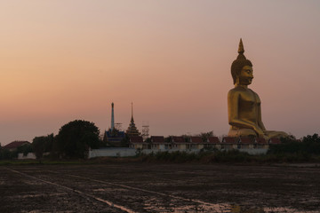 Big Buddha in Thailand with twilight sky at sunset