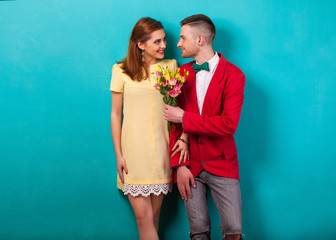 emotional fashion couple give each other flowers on.Valentine's Day. Vogue style