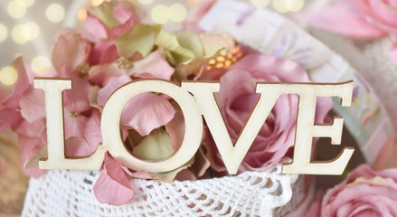 wooden letters LOVE on floral background
