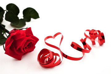 Red rose with ribbon stock images. Romantic roses on a white background. Red ribbon in heart shape. Valentines Day concept