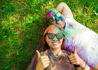 Guy with a girl celebrate holi festival, make selfie