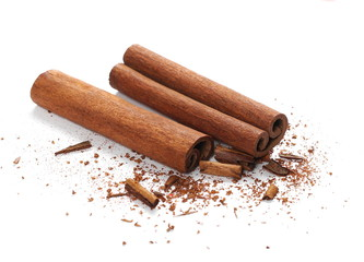 Cinnamon sticks with shavings isolated on white background