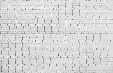 Brick wall painted with white paint.