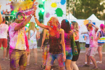Guys with a girl celebrate holi festival