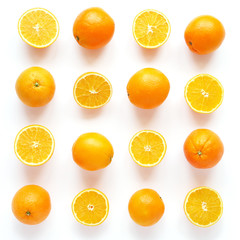 Fototapete - Creative flat layout of fruit, top view. Sliced orange isolated on white background. Food wallpaper, composition pattern of fresh citrus fruits.